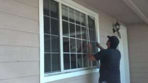 black hat installer installing custom window screens