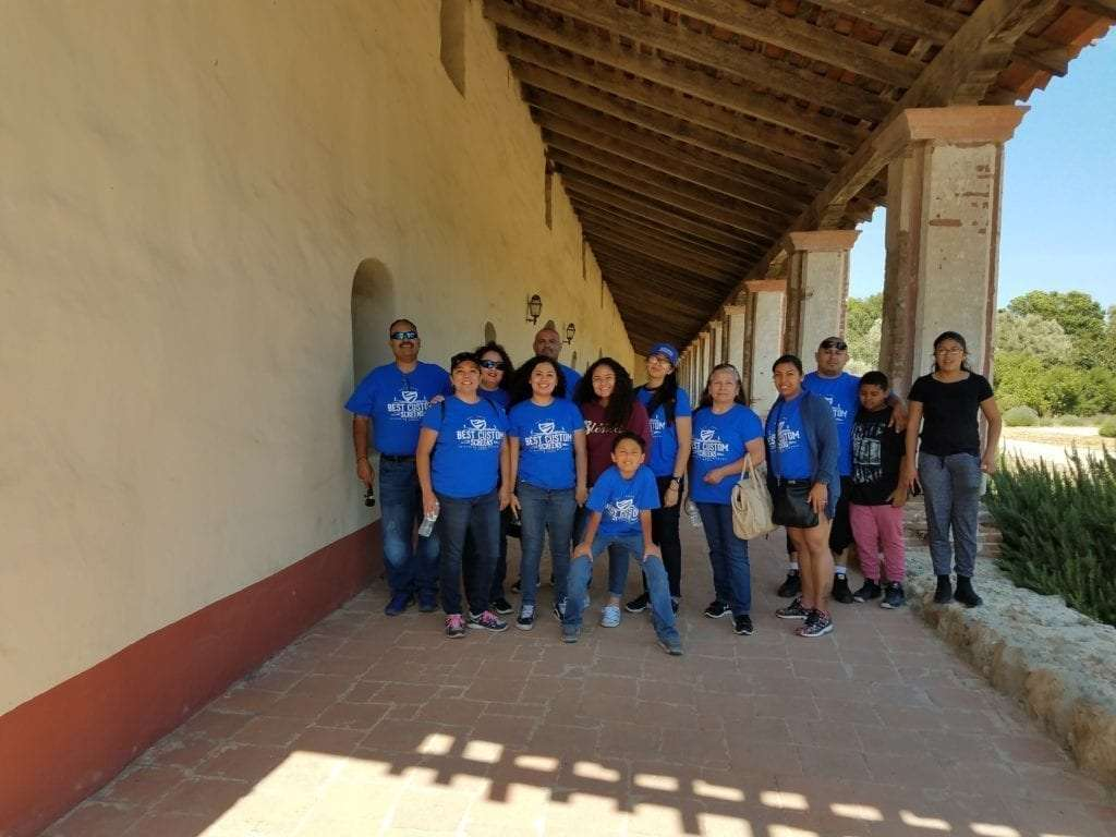Company employees blue shirt Best Custom Screens mission trip